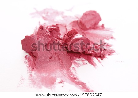 isolated red lipstick smashed on white background