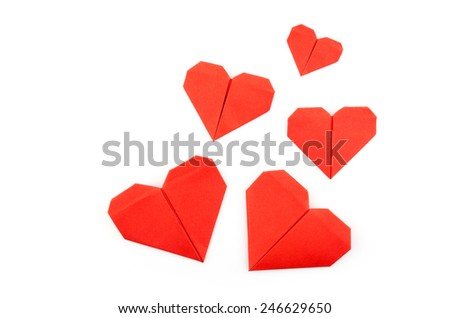 Isolated red paper origami heart for Valentine's Day symbolizing love - stock photo