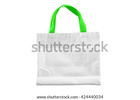 Isolated reuseable white fabric bag with green handle