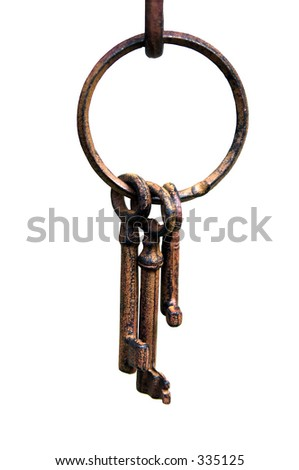 Isolated Ring of antique iron skeleton keys hanging on a hook