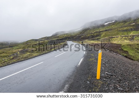 Isolated road and mountain landscape at Iceland, summer, 2015