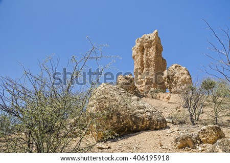 Isolated rocky hills left behind after volcanic activity, known as Vingerklip in the valley of Ugab River. Tourist attraction in  Damaraland, Namibia. - stock photo