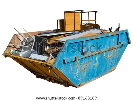 Isolated rubbish skip full of old office furniture. - stock photo
