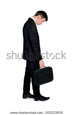 Isolated sad business man with suitcase