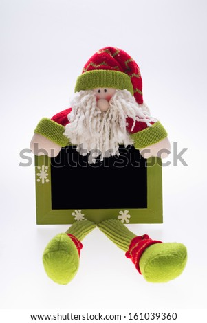 isolated Santa Claus figurine with plat on white background - stock photo