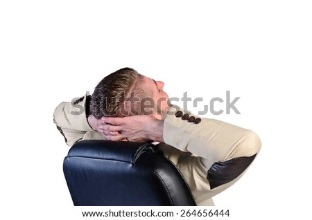isolated satisfied man relaxing on chair - stock photo