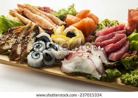 Isolated seafood set on brown plate - stock photo