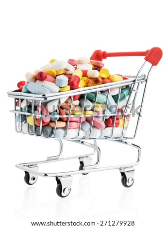 Isolated shopping cart full with pills and capsules - stock photo