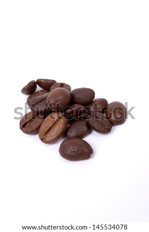 Isolated shot of coffee beans - stock photo