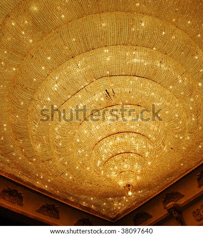 isolated shot of Home interiors Chandelier on ceiling - stock photo
