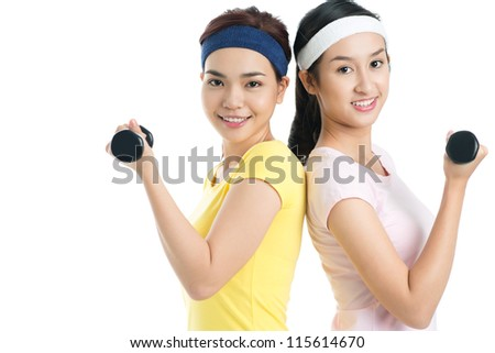 Isolated shot of lovely females working out with dumbbells - stock photo