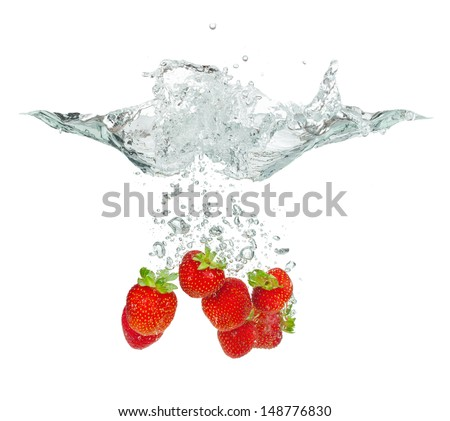 Isolated shot of strawberry falling into water, isolated on white background - stock photo