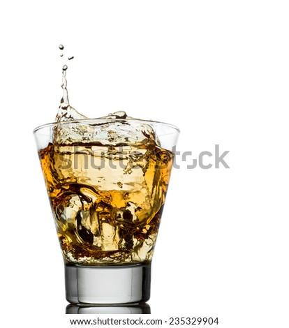 Isolated shots of whiskey with splash on white background - stock photo