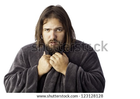 isolated sick man bundled up in a robe - stock photo