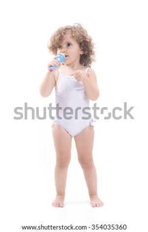 Isolated singing blonde female child with microphone