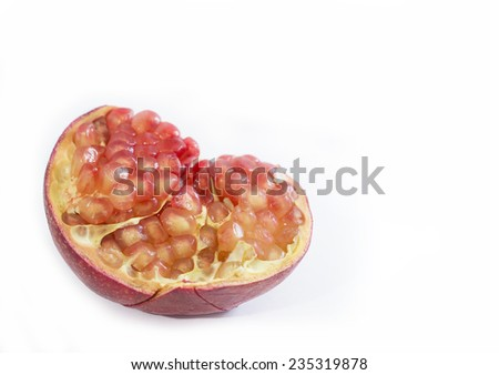 Isolated slice of pomegranate with arils (seeds) showing