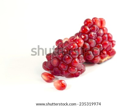 Isolated slice of pomegranate with arils (seeds) showing - stock photo