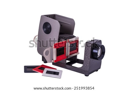 Isolated slide projector and slides - the old equipment - stock photo