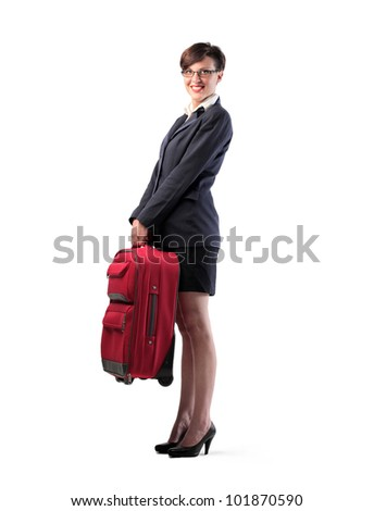 Isolated smiling businesswoman holding a trolley case - stock photo