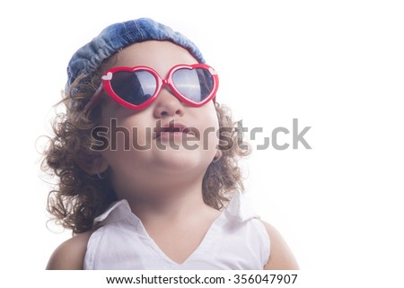 Isolated smiling female child with red sun glasses looking up