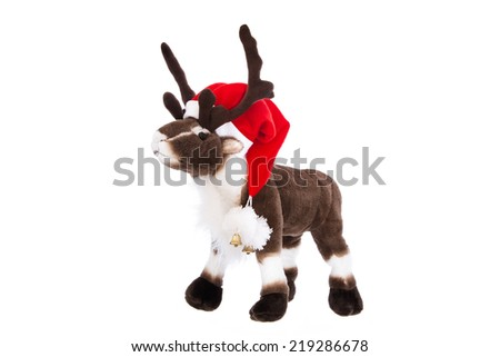 Isolated soft toy: Reindeer Rudolph with red christmas hat. - stock photo