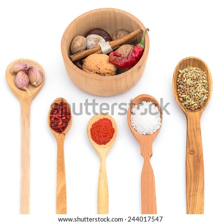 Isolated spices set in a wooden cutlery.
