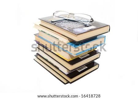 Isolated stack of books with glases