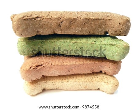 Isolated stack of colored dog treats shaped like bones