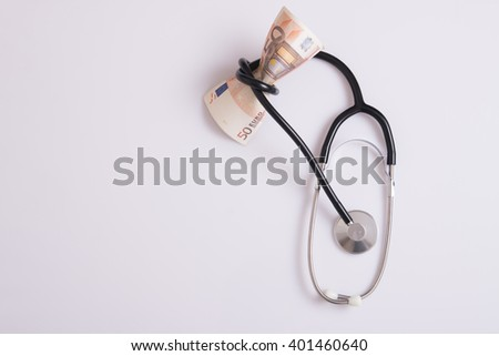 isolated stethoscope and euro money