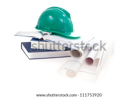 isolated still life with engineer's helmet books and projects - stock photo