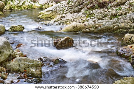 Isolated stones on a mountain stream