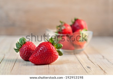 isolated strawberry isolated on rustic wooden background - stock photo