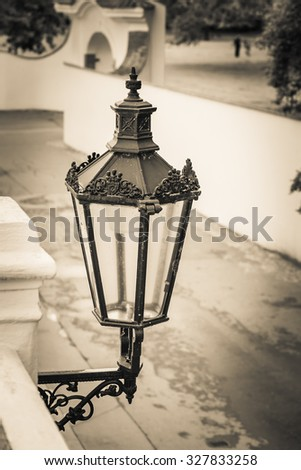 isolated street lamppost in sepia - stock photo