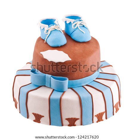 isolated striped cake with baby bootee - stock photo