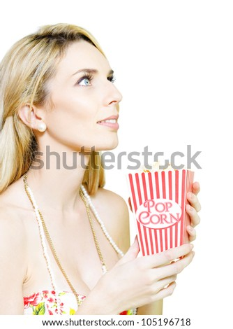 Isolated Studio Portrait Of A Woman Looking Onto Blank Copy Space While Holding A Iconic Striped Popcorn Box In A Film And Movie Concept, White Background - stock photo