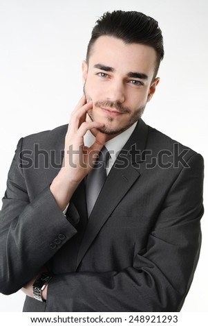 isolated studio portrait of a young business man on white background