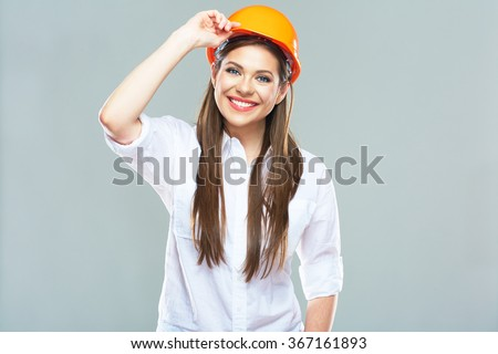 Isolated studio portrait of smiling woman manager of real estate. Business woman wearing protect helmet.