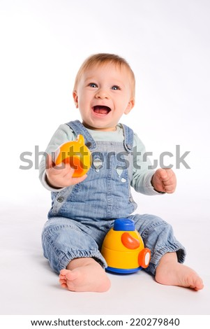 isolated studio portrait on white background of a lovely toddler baby boy playing and laughing - stock photo