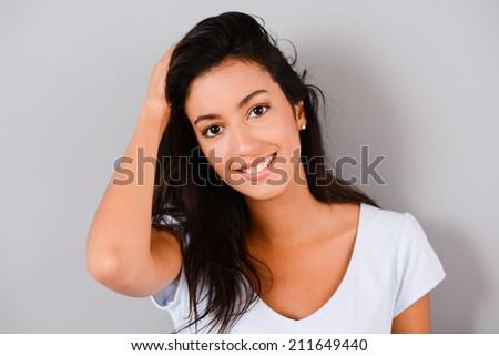 isolated studio shot of a beautiful and cheerful young brunette - stock photo