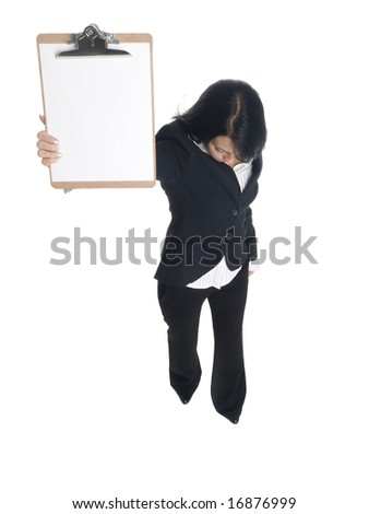 Isolated studio shot of a businesswoman presenting a blank clipboard while looking down.