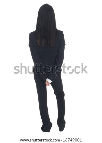 Isolated studio shot of a businesswoman waiting with her hands clasped behind her back.