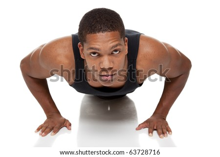 Isolated studio shot of a muscular man doing pushups - stock photo