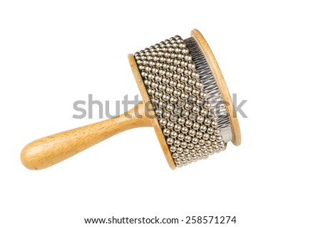 Isolated studio shot of an afuche, a rattle percussion instrument - stock photo