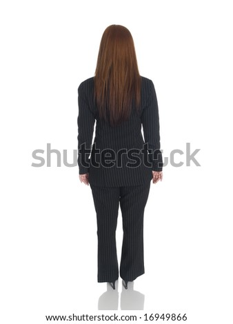 Isolated studio shot of the back side of a businesswoman standing with her arms at her sides.