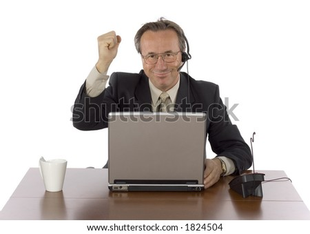 isolated successful businessman at the desk with headset