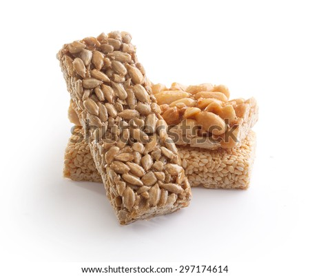 Isolated sunflower, sesame and peanut brittles brick on the white background