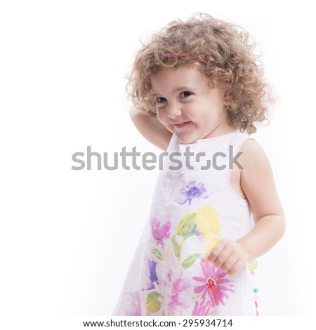 Isolated sweet female child portrait and smiling over white background