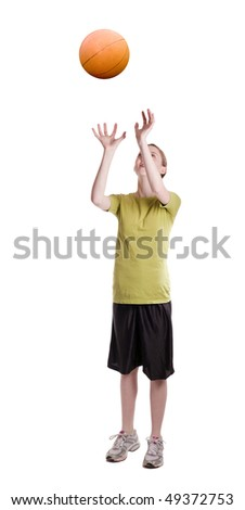 isolated teen age girl catching a basketball - stock photo