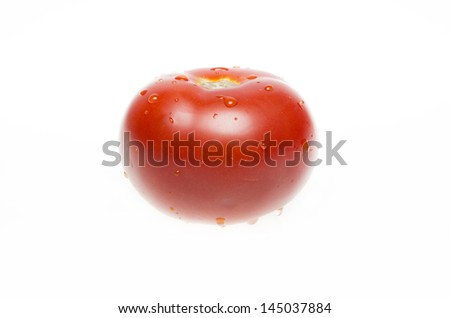 isolated tomato with water drops - stock photo