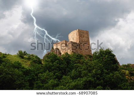 isolated tower in the forest under the lightning - stock photo
